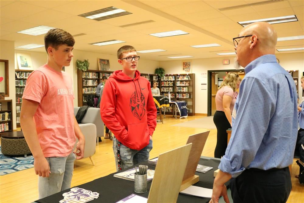 Students speak to a representative from Houghton College.
