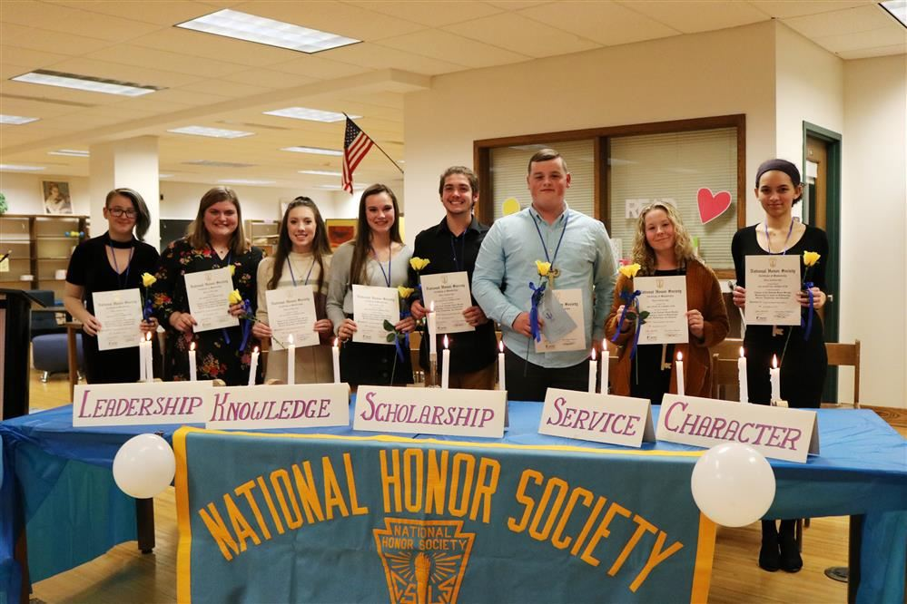 New NHS students pose with their certificates of membership